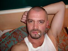 man 026-1 (SkinHH) Tags: gay feet goatee skin smoking hairylegs skinhead