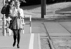 Communicative female tram passenger (Amsterdam RAIL) Tags: street blackandwhite bw girl handy blackwhite portable chica noiretblanc zwartwit strasse cellphone blond blonde streetphoto rue fille mädchen gsm meisje noirblanc straat zw mobieltje blondine straatfoto modemoiselle stphotographia
