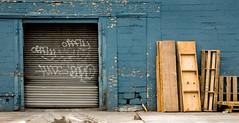 metal door in blue brick wall with wood (threecee) Tags: door wood newyorkcity blue newyork brick metal brooklyn graffiti peeling paint unitedstates crack sidewalk newyorkstate prospectheights pallet cracked 6thavenue flatbushavenue deanstreet atlanticyards forestcityratner bergentile dsc8731 prospectheitghts tracycollinsphotography brooklynian