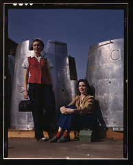 Two assembly line workers at the Long Beach, C...