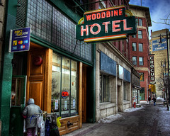 The Woodbine Hotel (bryanscott) Tags: street city woman building sign architecture shopping typography hotel winnipeg district main shoppingcart signage type woodbine cart exchange hdr photomatix