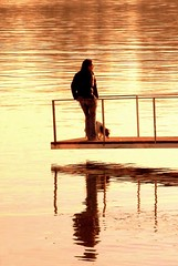 The Lady with the Dog (borkodinus Photography) Tags: sunset dog lady reflections golden silhouettes literature story fujifilm impression loner contralight chehov