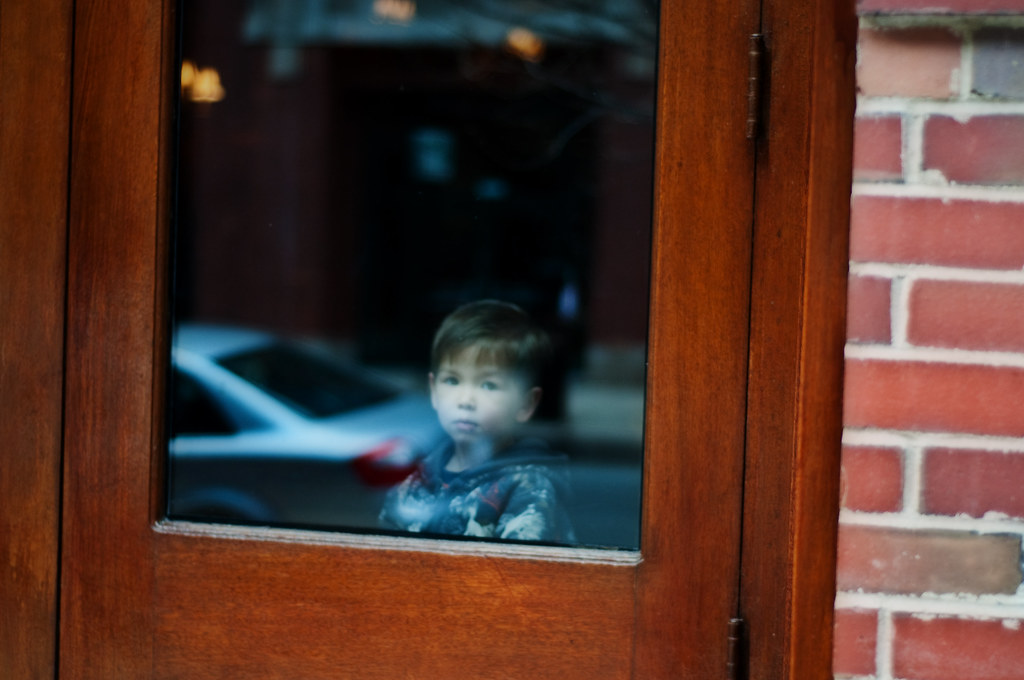 A little boy in the window at Reza's Restaurant.