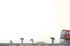 P1100834R Passage 4 - Bus,  Enlightenshade, Jon Perry,  6-6-11 (Jon Perry - Enlightenshade) Tags: bridge bus rain walking walk umbrellas walkers 6611 jonperry enlightenshade 20110606