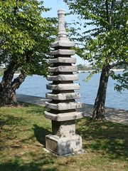 A Japanese stone pagoda compliments the cherry trees along the Tidal Basin