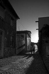 leaving (trazmumbalde) Tags: street girls sunset bw portugal contraluz arquitectura pessoas europe long shadows pb textures rua caminha diamondclassphotographer flickrdiamond flickrelite