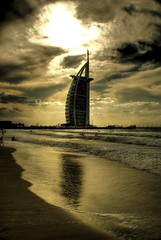Burj Al Arab (Muadh N M) Tags: world light shadow sea sky cloud sun reflection building beach water beautiful clouds dark fun sand dubai waves gulf wind sony muslim islam uae arab angry arabian alpha tone unitedarabemirates hdr burj