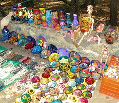 Skeleton Guarding Trinkets (cwgoodroe) Tags: blue food beach beer pool mexico sand surf markets palmtrees bowls zihuatanejo infinitypool fishingvillage trinkets tacostand cervesa sfchronicle intrawest zihua zhihua outdoormarket 96hrs playadelropa