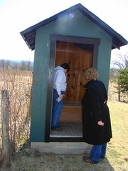 Inspecting the outhouse