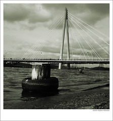 Marine Way Bridge, Southport, Low Shot (xstex) Tags: uk bridge blue england bw white black bird architecture clouds way polaroid marine europe shot unitedkingdom britain seagull united low great kingdom tire stephen 2008 southport robinson seagul merseyside stephenrobinson stephenrobinsonphotography xstex
