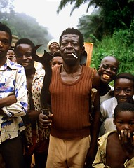 The Cheif (Amanda) Tags: africa family people black men nikon cigarette badass crowd smiles smoking jungle leader fe tribe cheif africans machetti africanchildren