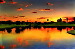 Stillness And Fury (jimhankey) Tags: park sunset arizona sky orange cloud sun reflection tree fall water phoenix weather topv111 landscape gold golden pond topv333 desert cloudy scenic naturallight sunny topv222 corona vista orangesky dramaticsky hdr beautifulclouds beautifulview sunray desertview 2007 eveninglight phoenixarizona waterreflection beautifulscenery afternoonlight phoenixaz cumulous scenicview orangesunset blueribbonwinner nikond200 unusuallight glowingcloud indianschoolpark orangecloud uptownphoenix jimhankey arizonaweather phoenixweather phoenixariz arizonafall