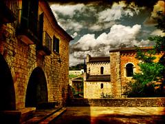Streets of Girona (XII) (ToniVC) Tags: sunlight canon vintage balcony girona powershot porch aged dramaticsky textured 2007 santperedegalligans oldstone barrivell a640 passeigarqueolgic tonivc riugalligans sog12 passeigpergirona plaadelsjurats