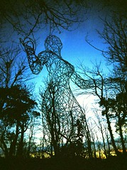Orchestrates... (Trapac) Tags: uk blue winter england sculpture film lady woodland xpro crossprocessed cornwall kodak hill slidefilm plasticfantastic installation elitechrome vivi vivitar plasticcamera 400iso kernow lostgardensofheligan kodakelitechrome wmh staustell greylady pentewan gardenstatuary vivitarultrawideslim vivitarultrawideandslim thegreylady vivitarroll5 vivitarws suepetehill heliganslostgardens