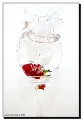 Project: Strawberry #1 (Fraggle Red) Tags: red white green water glass fruit strawberry raw flash splash onwhite firsttry eow freezemotion canonefs1785mmf456isusm flickrsbest adobelighroom canonspeedlite420ex colorphotoaward