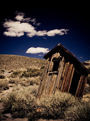The Outhouses of Bodie: IV (code poet) Tags: california wood sky topf25 topc25 topv111 clouds landscape topv555 topv1111 topv999 toilet 100v10f topv topv777 shack bodie 333 outhouse 28135mm ghostown