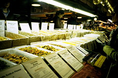 choosing the pasta (Viv | Seattle Bon Vivant) Tags: seattle film analog washington farmersmarket rangefinder ishootfilm pikeplacemarket filmcamera expired analogphotography f28 nopostprocessing olympusxa downtownseattle 60minutephoto vintagefilmcamera fujichromeprovia1600professional