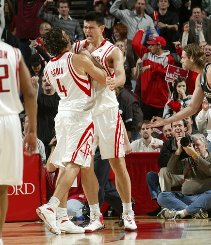 Yao Ming celebrates with teammate Luis Scola after Yao grabbed a huge rebound and threw it down against Tim Duncan late in the Rockets' game against the Spurs.  Yao scored 21 points and grabbed 14 boards in an intense victory to help Houston snap a two-game losing streak.