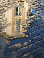 The last of Raguzzini (promise!) (frscspd) Tags: blue rome reflection rain canon interestingness paddle sampietrini 1727 pavet piazzasantignazio platinumphoto filipporaguzzini raguzzini