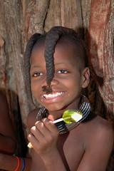 Himba Girl with Lollipop (Peter Schnurman) Tags: girl candy braids namibia himba thirdworld opuwo developingworld