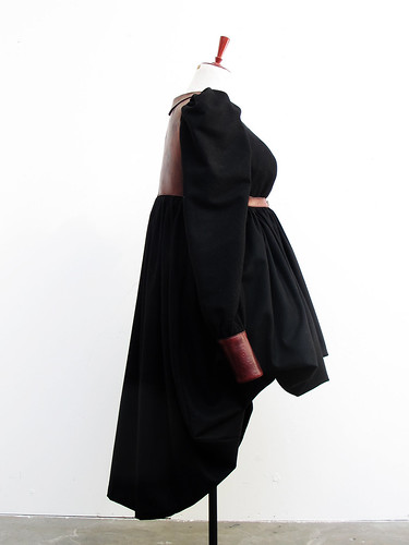 bara baras - coat draped side