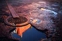 Cloaca Maxima (Chris Beauchamp) Tags: street pink blue orange reflection calgary canon alley pavement drain alberta mission tamron1735 xti copyrightchrisbeauchamp20072009
