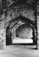 Hallway at the Golconda Fort (arohilla) Tags: blackandwhite bw india architecture fort bricks hallway 55mm repetition paths hyderabad pathway islamic hpc southernindia andhrapradesh canonftb historicindia golcondafort