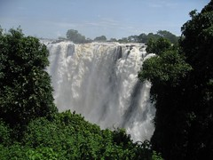 Thundering Victoria Falls (peggyhr) Tags: africa trees sky sunlight white mist green nature water clouds victoria falls spray zambia mywinners superbmasterpiece peggyhr goldsealofquality visiteesselugar
