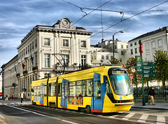 A Ride in Brussels (` Toshio ') Tags: brussels people woman man men history tourism yellow architecture buildings women europe downtown dynamic belgium tram tourists transportation historical marketplace hdr europeanunion toshio highdynamicresolution