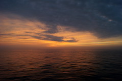 The sky is lovely, dark and deep, (EqualFooting) Tags: sunset sky orange blue black white water clouds ripple twilight gulfofmexico