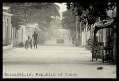 The dusty streets of Brazzaville (andreea_gerendy) Tags: africa street city trip trees winter vacation bw men cars dusty car shop walking town jeep african wheelchair dirt payphone congo february dust pespective brazzaville congolese canoneos50d andreeagerendy