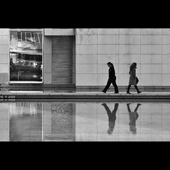 Urban coreographies (2) (trazmumbalde) Tags: street people urban bw portugal architecture arquitectura pessoas agua europe pass pb contact rua passing narrow reflexos matosinhos coreography eachother avoyding