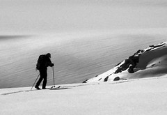 skier (xtremepeaks) Tags: winter bw snow canada mountains ice landscape person rocks alone skiing bc glacier skis skier icecap interestingness310 i500 aplusphoto explore15mar08