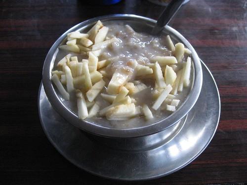Warm apple porridge with milk