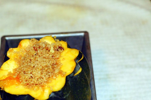 roasted acorn squash stuffed with spiced couscous in a wine reduction sauce