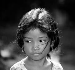 Candid Street Portrait, Cambodia (Loc BROHARD) Tags: street unicef portrait people blackandwhite bw slr girl look canon children temple blackwhite eyes cambodia cambodian khmer child candid buddhist streetphotography buddhism siem reap thom siemreap angkor bayon canoneos300 35mmslr tonlsap anawesomeshot flickraward earthasia memorycornerportraits  streetphotographycandidphotography