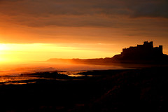 Bamburgh castle. (Ian McWilliams.) Tags: greatbritain morning sea castle sunrise canon 350d dawn sand northumberland 1855mm bamburgh soe efs bamburghcastle blueribbonwinner northeastengland aplusphoto diamondclassphotographer flickrdiamond ysplix theunforgettablepictures macaz1977