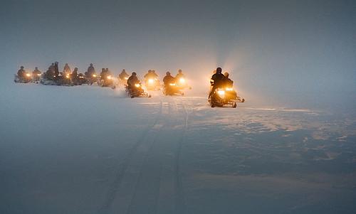 Snowmobiles on a glacier