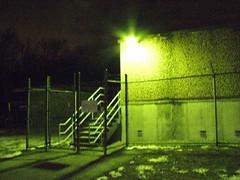 Radioactivity (Gazing Ball) Tags: barbedwirefence greentint concretebuilding