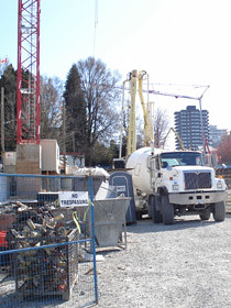 A truck emerges at the Cambie-Broadway construction site