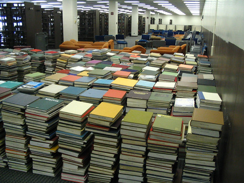 Huge stacks of books at the University of Illinois Undergraduate Library during rearranging