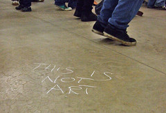 This Is Not Art - this is flashmobbing Tate Modern (12 October, 2007) (chrisjohnbeckett) Tags: urban london art graffiti chalk dance ipod message text tatemodern turbinehall explore irony paradox flashmob dancingshoes cecinestpasunepipe mobileclubbing thisisnotart chrisbeckett chalkmark urbanechoes