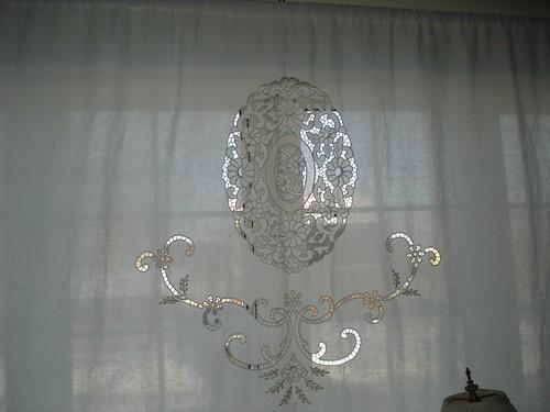 Vintage cutwork linen used as curtain, via teacup design