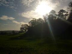 sun over bottom of ashton court (dandavie) Tags: uk trees sky sun field grass clouds forest woods hill blaze ashtoncourt sunthroughclouds blazingsun