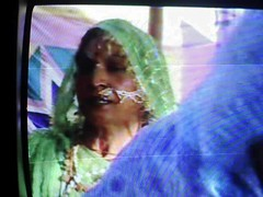 A Singing Eunuch (sunkisland) Tags: india television singing extreme religion bbc pilgrim saddhus eunuchs sunkisland