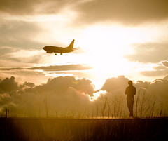 Iona Silhouette (Airchinapilot) Tags: sunset woman sun canada art beach silhouette clouds plane canon person bc horizon richmond wetlands yvr airliner 30d ionabeach 100400l