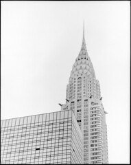 Chrysler Building (Stephen J. Alexander) Tags: blackandwhite white newyork black blancoynegro film blanco monochrome outdoors blackwhite noir pentax negro hyatt empirestate 6x7 weiss blanc schwarz blancetnoir weis negroyblanco lonelycity schwarzundweiss sjalexander schwarzundweis sjalex sjalex76 stephenjalexander sjalexandernet