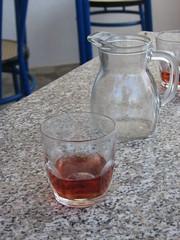 A glass of homemade wine (lisannekerstens) Tags: table wine greece samos tafel wijn griekenland svalabeach kamposvourlioton