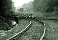 Train Tracks in Charlotte, NY (-dangler) Tags: railroad trees summer bw ny newyork blur fog train ties outdoors smog rocks charlotte outdoor stones steel scenic tracks rail blurred trains line rochester explore greece journey transportation heat infrastructure rails curve switches nys westernnewyork wny csx freightyard monroecounty blurring lakeave hojack theperfectphotographer