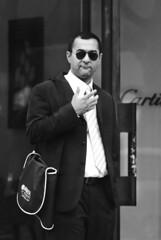 portrait people man paris france sunglasses alone hand streetphotography cartier olympus ff 08 euope e510